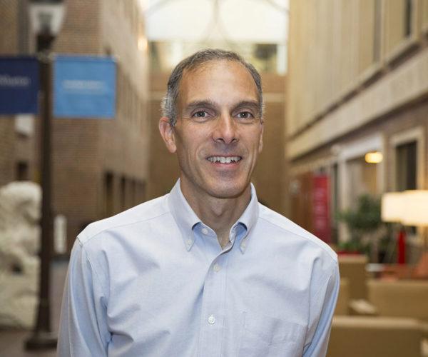 Headshot of Prof. Cachon in a light blue shirt standing inside a Wharton building
