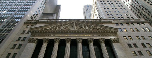 A shot looking up at the New York Stock Exchange and surrounding skyscrapers